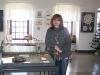Małgosia Oleszczyk przy gablocie ze swoimi pracami
